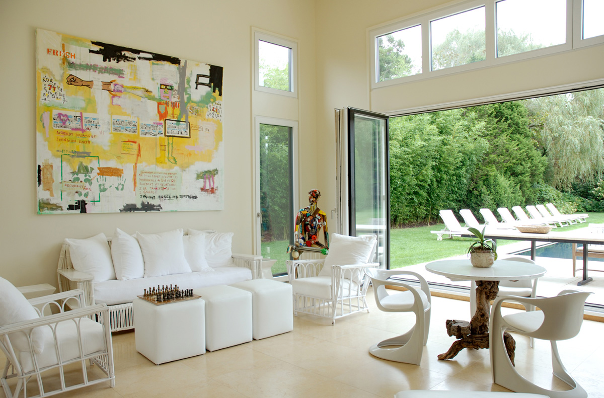 Charming-Sunroom-Sets-with-White-Wall-Paint-and-White-Flooring-and-Deluxe-White-Sofa-using-Fancy-White-Pillows-and-Two-White-Chairs-and-Cozy-Dining-Room-plus-Wall-Mounted-Art-and-Glass-Sets.j