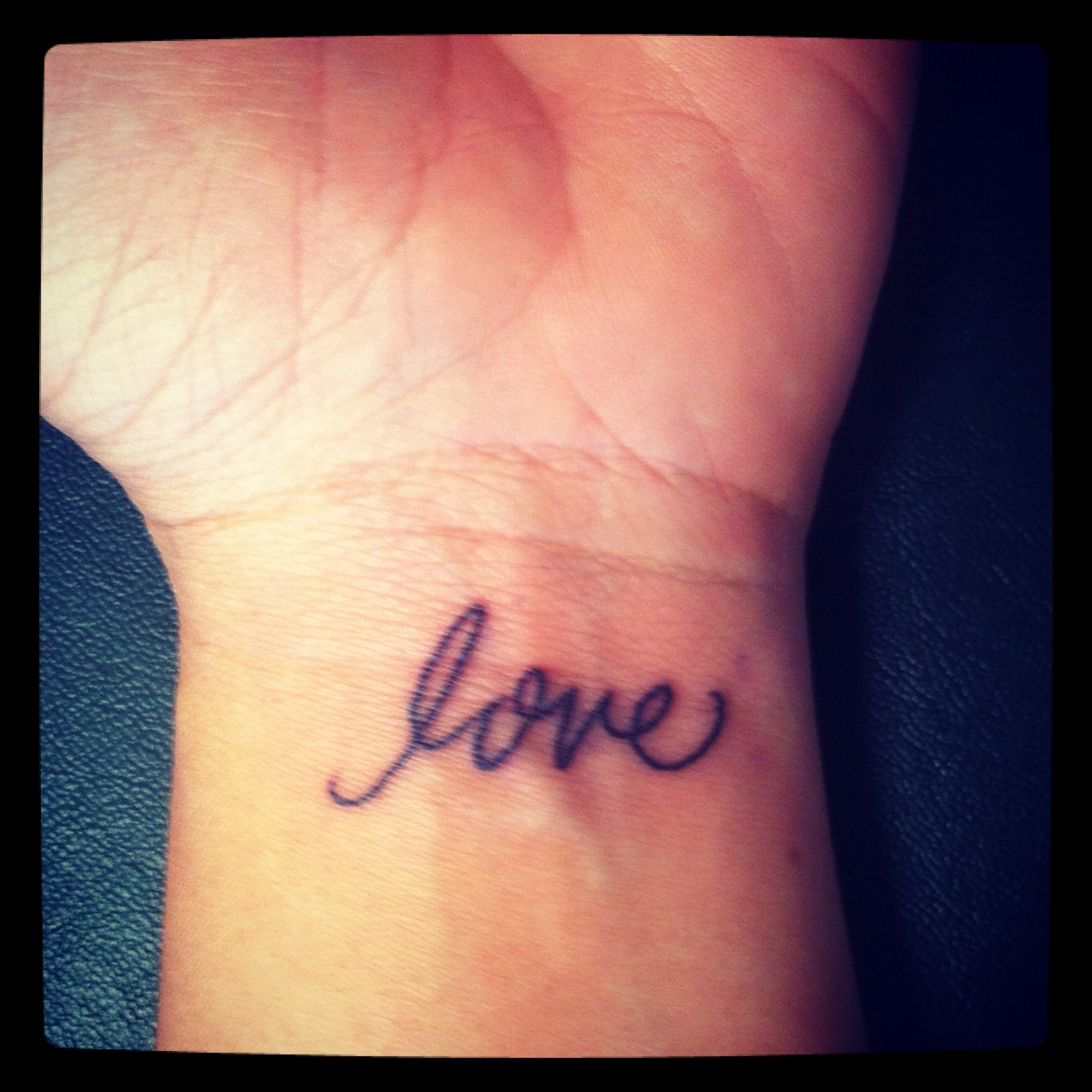 Men-small-heart-on-wrist-tattoo