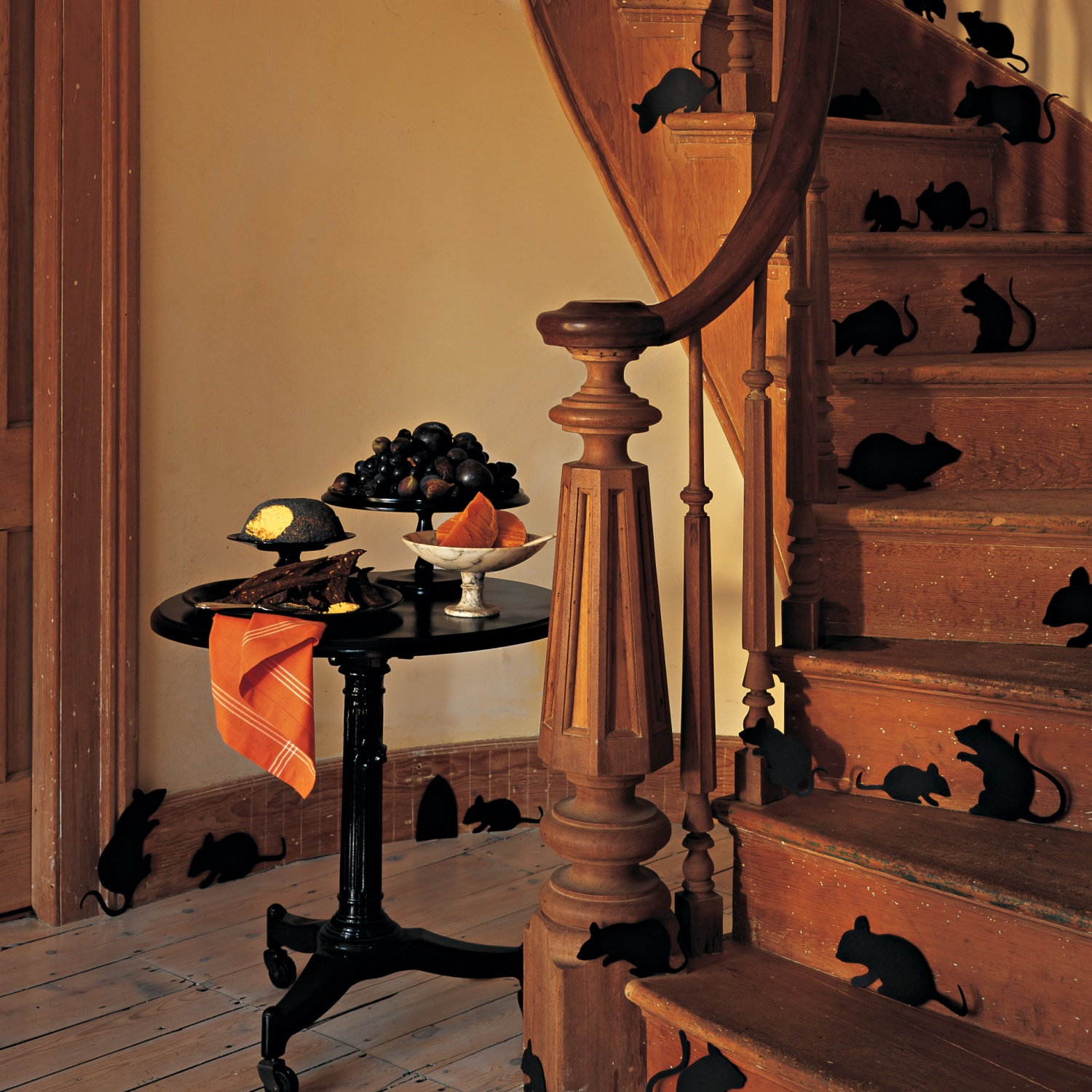 lots-of-fake-mice-on-staircase-idea-plus-round-console-table-with-black-grapes-or-great-handmade-halloween-decoration-outside